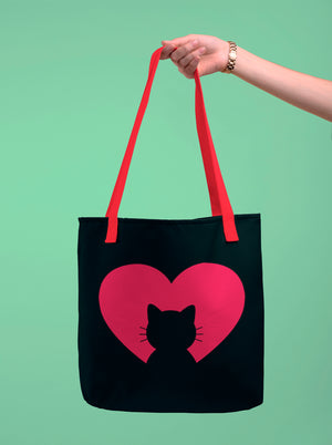 Photo-of-a-hand-holding-a-black-tote-bag-with-red-straps--WearPet--I-love-my-cat