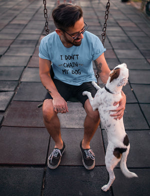 Photo-of-a-man-petting-his-dog-at-a-playground-wearing-a-heather-blue-tshirt-Wear_Pet-I-dont-chain-my-Dog-tee
