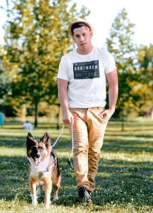 Photo-of-a-man-walking-his-dog-at-a-park-wearing-a-grey-t-shirt---Wear-Pet---DOG-WALK-ON-TIME