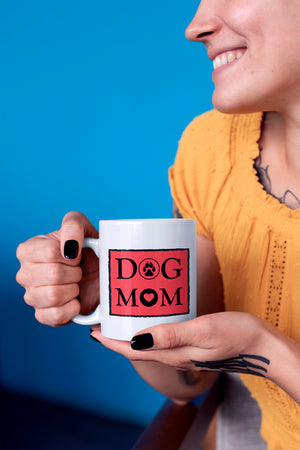 Photo-of-a-smiling-woman-holding-a-11-oz-mug-WearPet-DOG-MOM