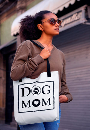 Photo-of-a-woman-with-sunglasses-carrying-a-white-tote-bag-with-black-straps-on-her-shoulder-WearPet-DOG-MOM