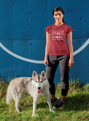 Photo-of-a-young-woman-standing-next-to-her-dog-wearing-a-red-t-shirt-WearPet-DOG-MOM
