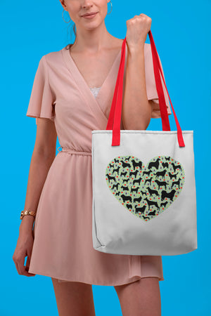 Photo of a Woman holding a White Tote Bag with red straps - Wear Pet - Dogs Lover