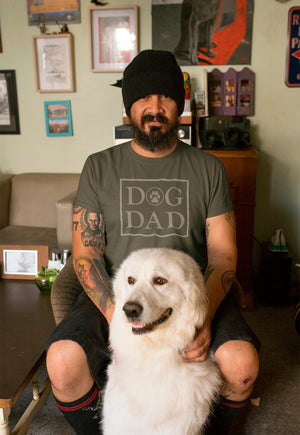 Photo of a man-at-home-with-his-dog-wearing-a-Army-color-tshirt- Wear_Pet - DOG DAD