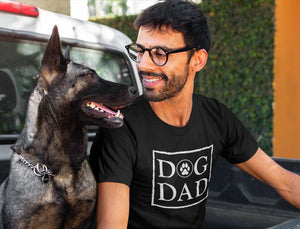 Photo of a man-smiling-at-his-dog-wearing-Black a-tshirt-on-the-back-of-a-truck - Wear_Pet - DOG DAD