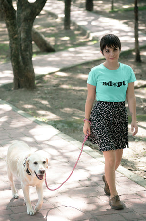 Photo of a women walking her dog- Wear_Pet - light GREEN  tshirt - Adopt Collection