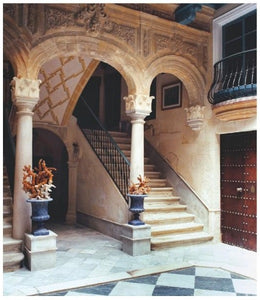 stone and marble staircase with balcony