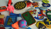 80s erasers and badges