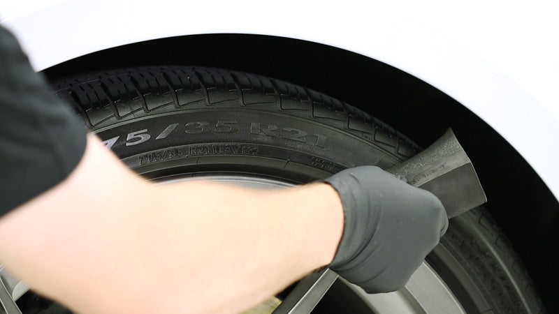 Applying CarPro Blackout coating onto the tire's rubber sidewall