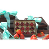 A box of hand-painted chocolate filled with a blend of strawberry and chocolate ganache