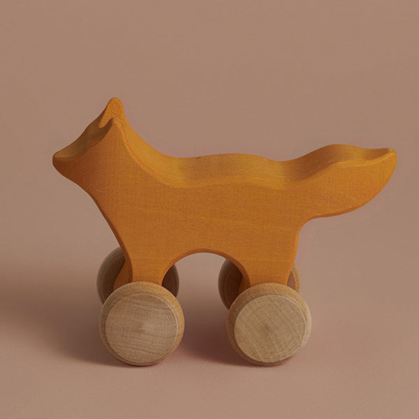 wooden rolling fox toy