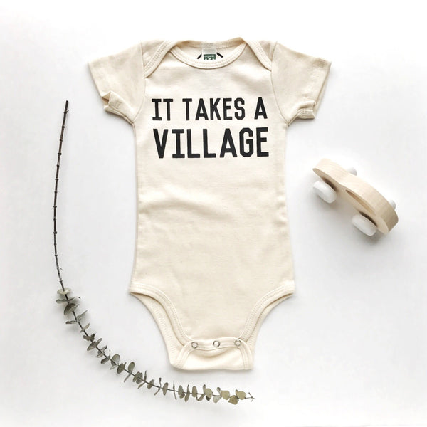 onesie it takes a village (natural)