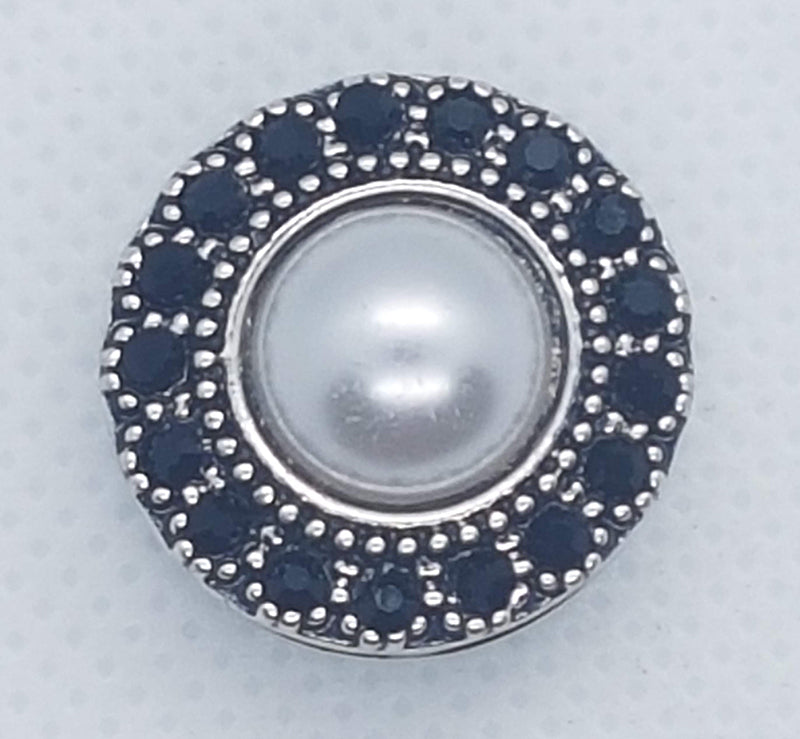 Round snap with black rhinestones and a pearl