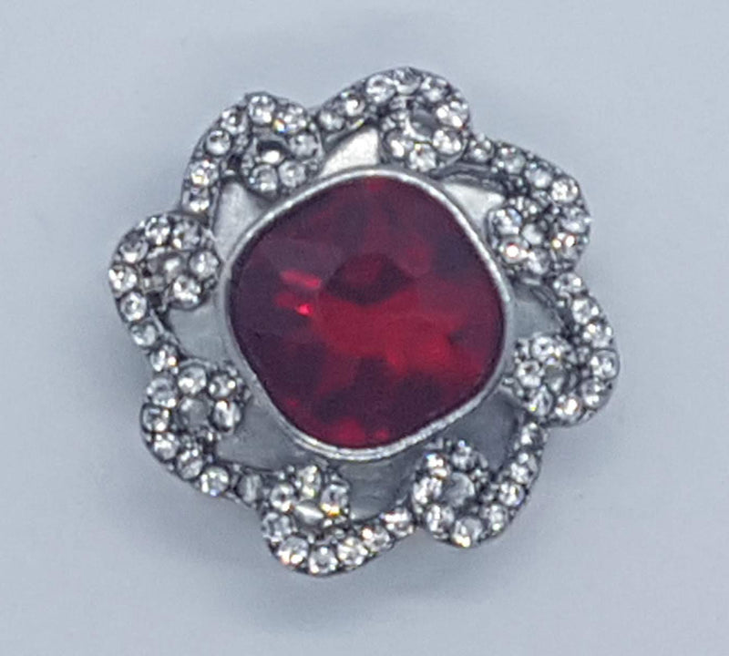 Flower shaped with large red rhinestone