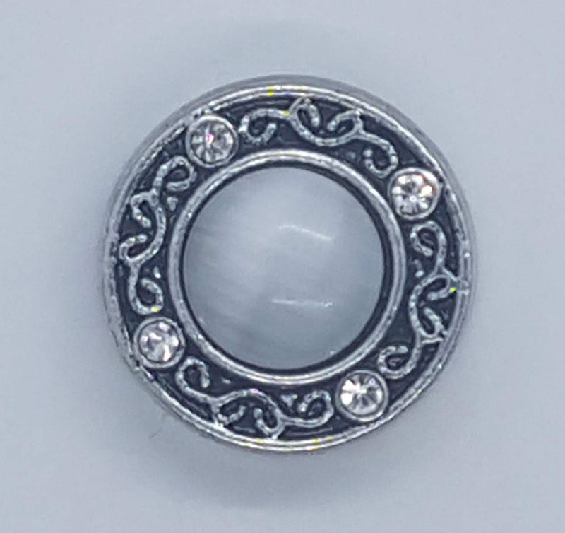Round gem with white cat's eye stone