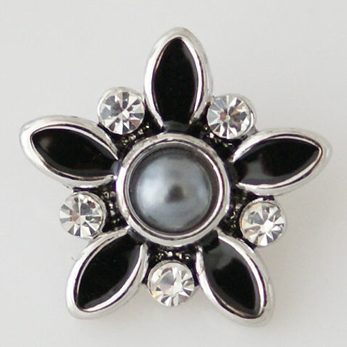 Flower shaped snap with a black enamel and grey pearl