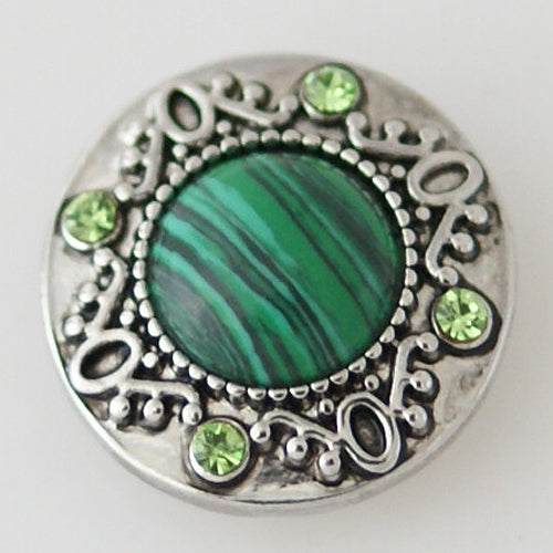 Antique snap with small green rhinestones and a large green semi-precious stone