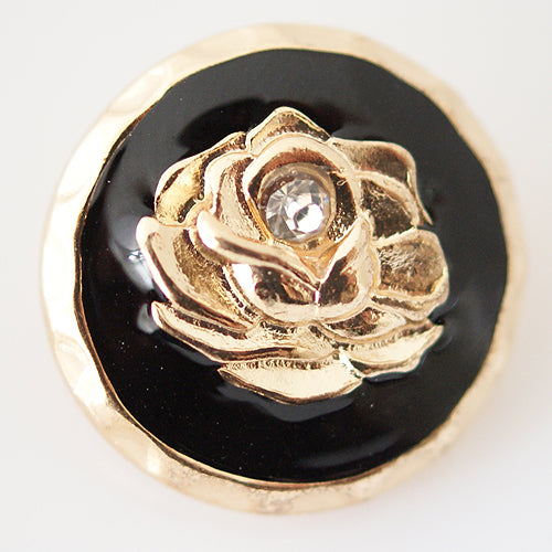 Round gold plated snap with flower in black enamel