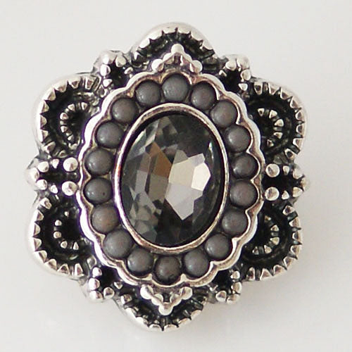 Irregular shaped snap with small black beads and a black rhinestone