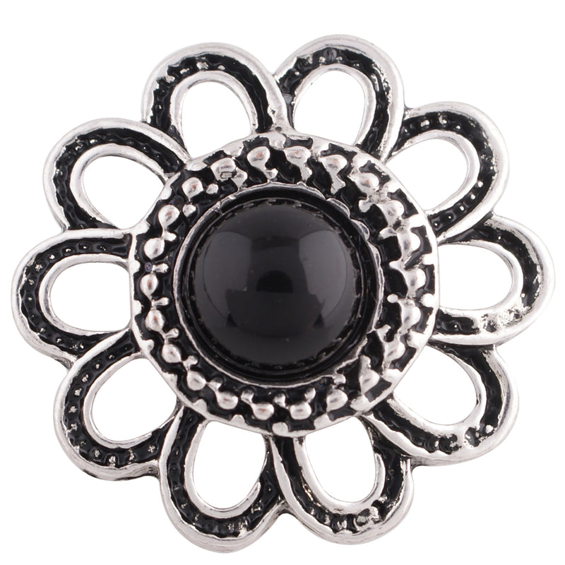 Flower shaped snap with a black stone