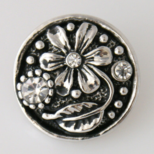 Flower with small clear rhinestone