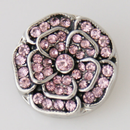 Flower shaped snap with pink rhinestones
