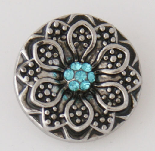 Flower with small blue rhinestones
