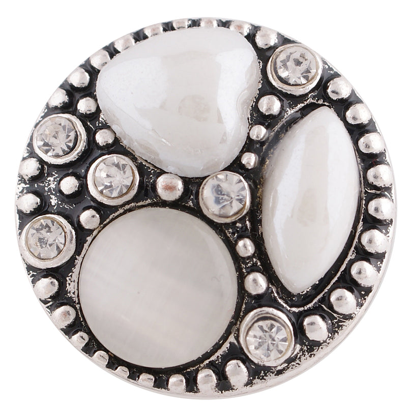 Round snap with irregular shaped white stones