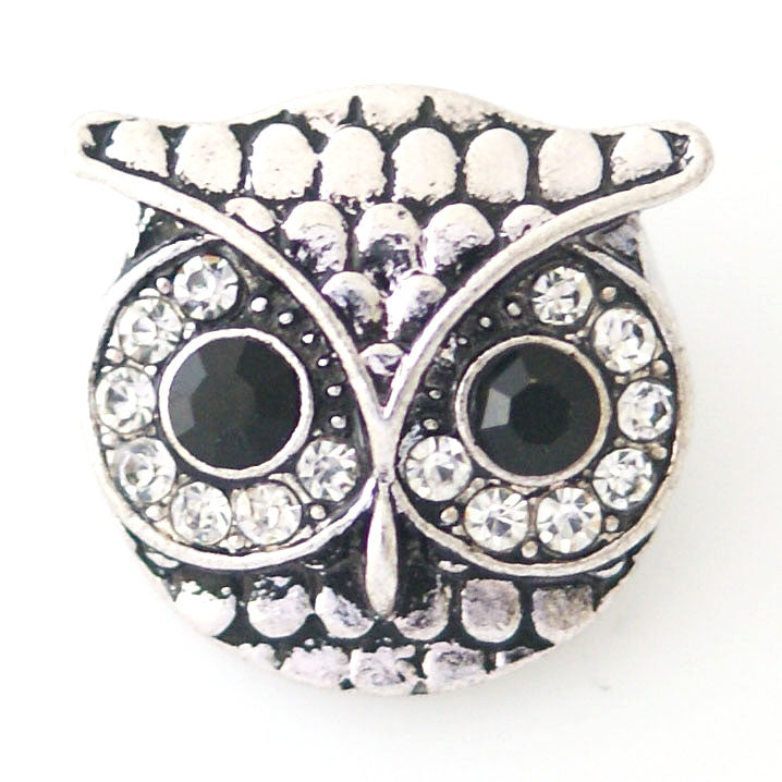 Antique owl with black and clear rhinestones