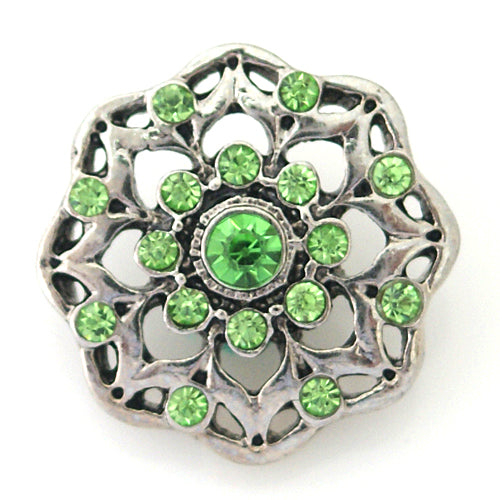 Flower shaped snap with small green rhinestones
