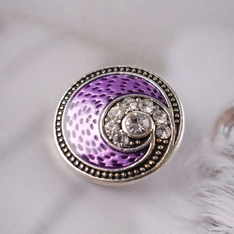 Round vortex design snap with purple enamel and clear rhinestones