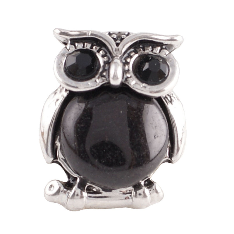 Owl with black stone