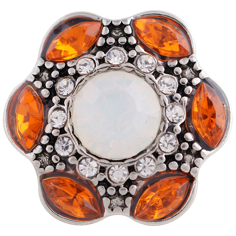 Flower shaped snap with orange rhinestones circling a large white rhinestone