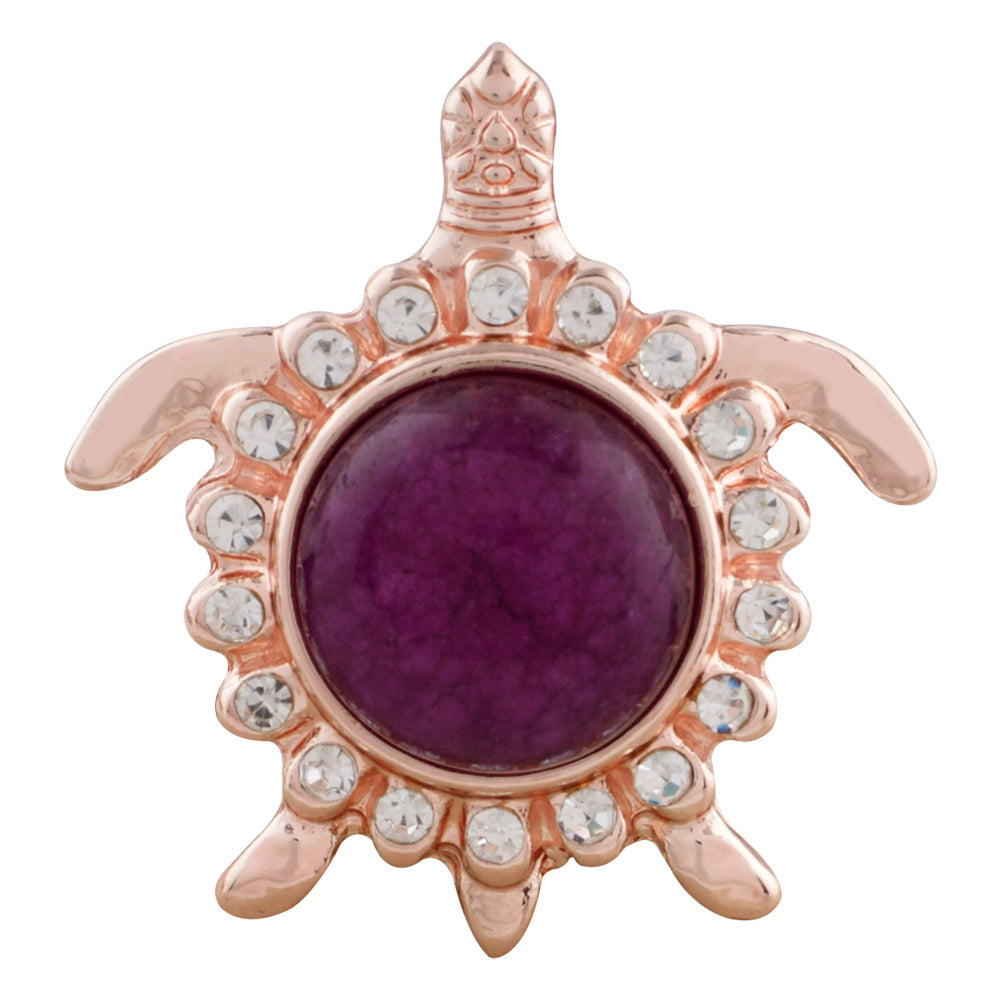 Gold turtle with purple semi-precious stone