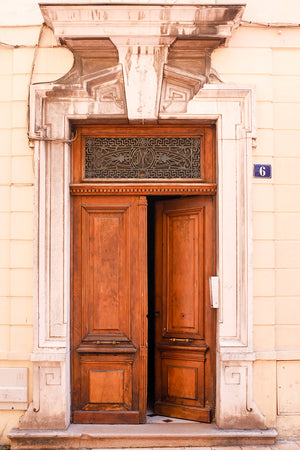 Brown door in Menton France - Every Day Paris