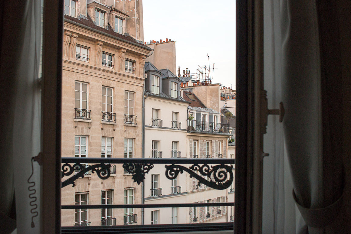 Window onto Place Dauphine - Every Day Paris