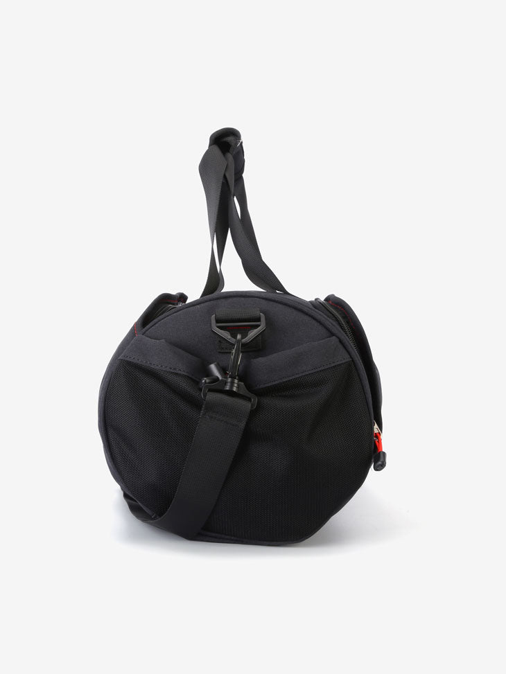 The Trainer Cylinder Duffel in Black