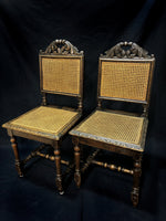 Pair of Carved Cane Chairs