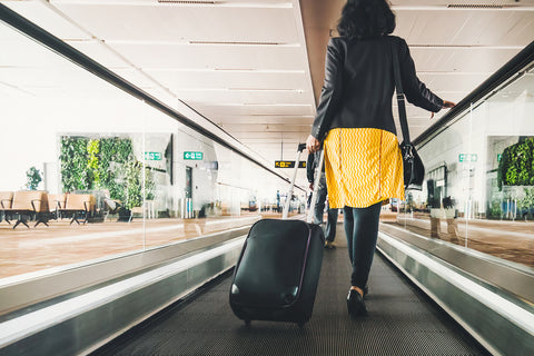 8 Beauty Travel Hacks suitcase airport
