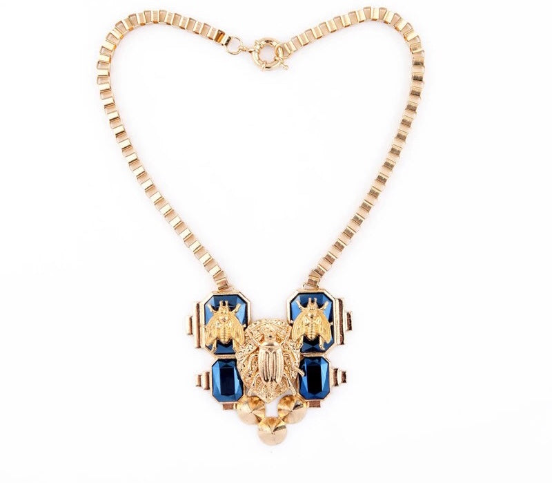 SALE ITEM- GOLD LINK NECKLACE WITH BEES AND BUHS AND BLUE DETAILED STONE