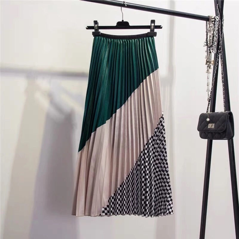 MELINDA- DIAGONAL PLEATED SKIRTS- 2 COLOURS