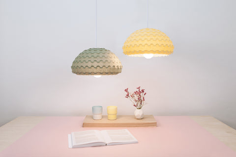 Green and yellow small bell pendant lamps from Kasa collection made by 24d-studio