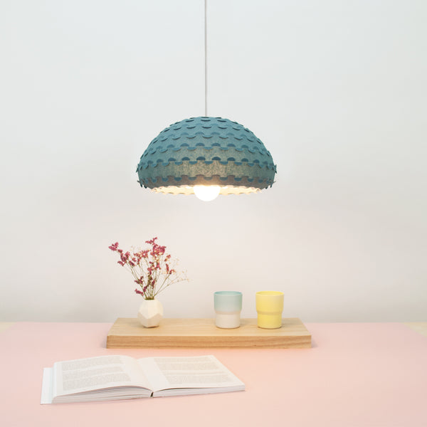 small bell blue ceiling lamp over dining table by 24d-studio
