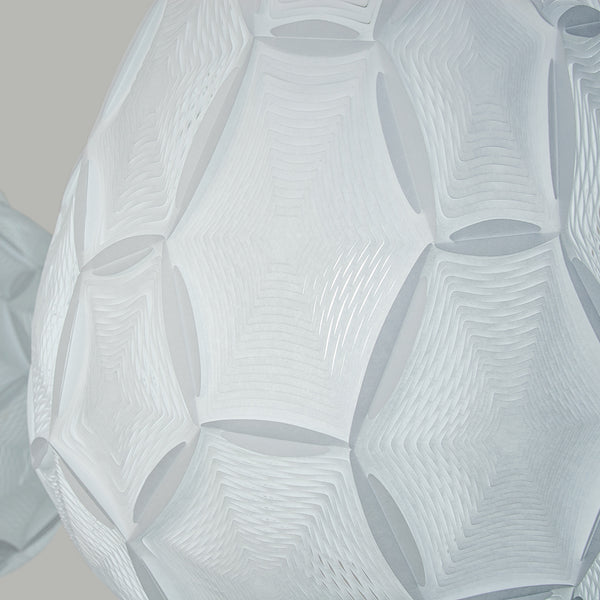 Airy Small Teardrop ceiling Lamp zoom-in detail of the white perforated laminated rice paper lampshade