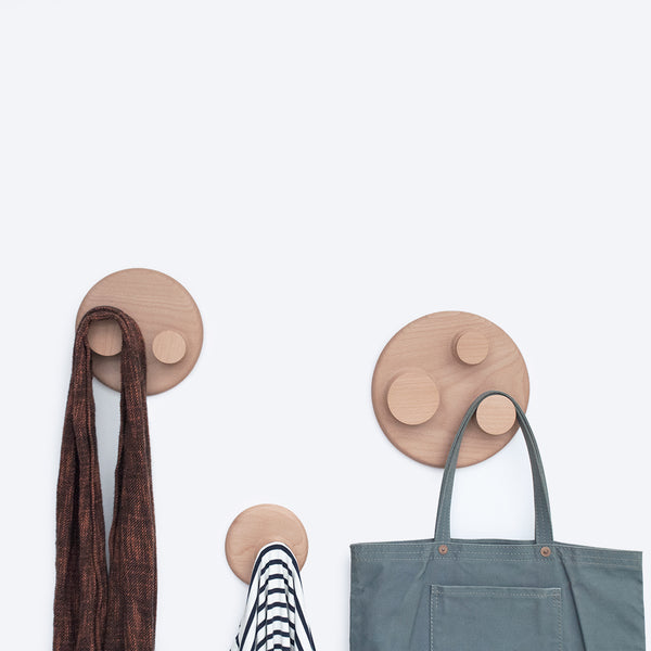Orbit Hook Collection consists of three various size wall hangers made in beech wood by 24d-studio