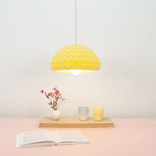 Yellow Kasa pendant lamp over dining table by 24d-studio