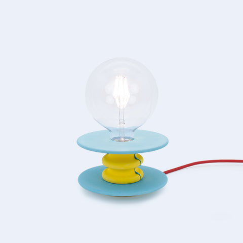 blue and yellow frutti table lamp is a perfect source of accent lighting and decor