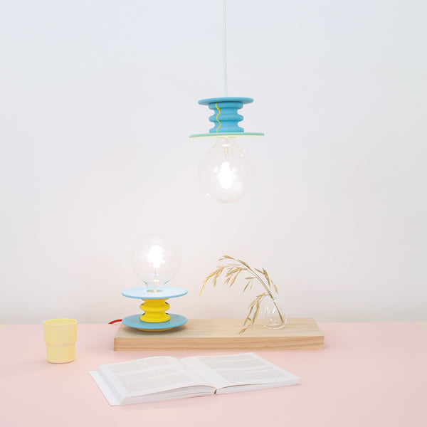 Frutti Lamp collection by 24d-studio consists of various color combination pendant and stand lamps allowing users to select their favorite.