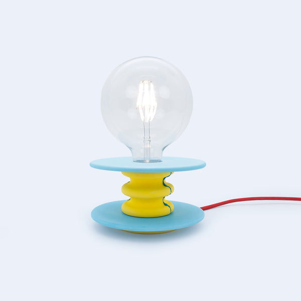 small desk lamp in yellow and blue stone like material made by 24d-studio