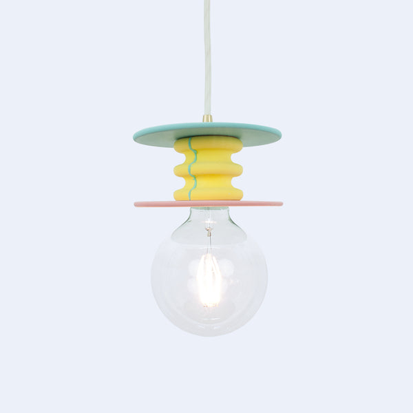 Frutti light is a series of bright ceiling lamps with colorful stone bases
